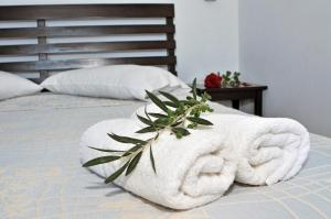 A bed or beds in a room at Elea Apartments