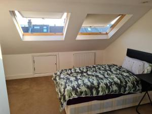 A bed or beds in a room at Evesham