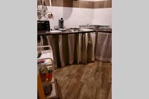 A kitchen or kitchenette at Grand Studio climatisé 55m2 proche Aéroport,Gare.
