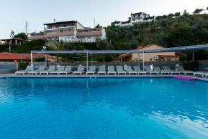 The swimming pool at or near Cabana Studios & Apartments