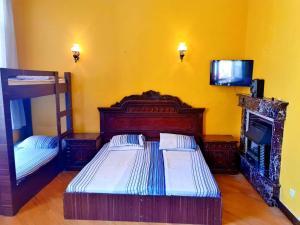 Cama ou camas em um quarto em Prime Hostel Baku