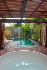 The swimming pool at or near Tegal Sari Accommodation