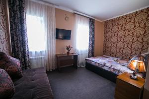 Кровать или кровати в номере Клеопатра Отель