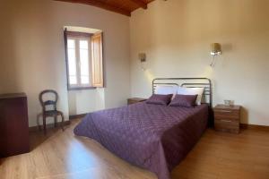 Uma cama ou camas num quarto em Casa de Sampaio - Castelo Mendo
