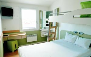 A bunk bed or bunk beds in a room at ibis budget Honfleur Centre