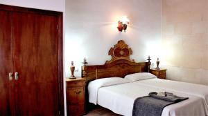 Cama o camas de una habitación en Finca Es Torrent
