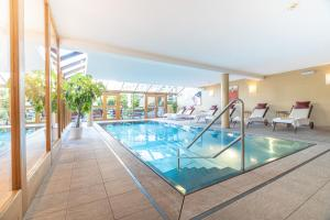 The swimming pool at or near Hotel Kaiserhof Kitzbühel, 4 Sterne Superior