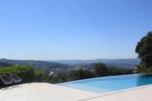 The swimming pool at or near Quinta Milhão - Casa da Horta