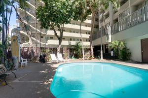 The swimming pool at or near Castle Waikiki Grand Hotel