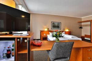 A television and/or entertainment center at Hotel Quellenhof