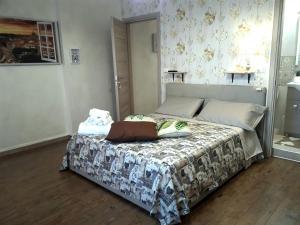 Cama o camas de una habitación en San Pietro Shabby Chic Apartment