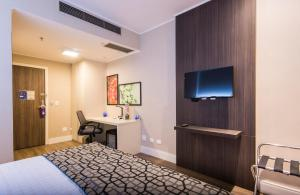 A bed or beds in a room at Transamerica Executive Taboao Morumbi