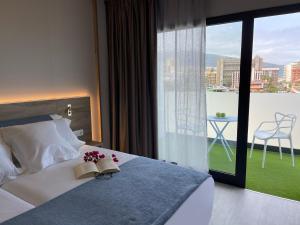 Een bed of bedden in een kamer bij Hotel Valle Orotava