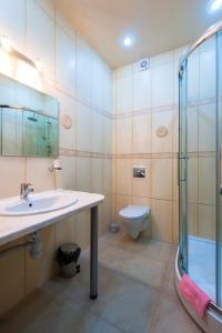 Ванная комната в Загородный Клуб Олимпия