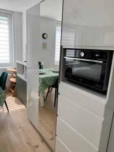 Cuisine ou kitchenette dans l'établissement Au 4qK Studio 2 pers Strasbourg Kléber Halles