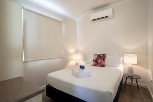 A bed or beds in a room at Darwin FreeSpirit Resort