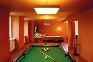 A pool table at Davos Youth Hostel