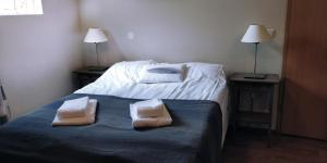 A bed or beds in a room at SAXA Guesthouse
