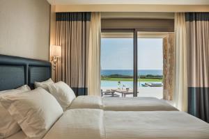 Letto o letti in una camera di Electra Kefalonia Hotel & Spa