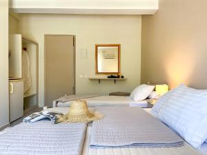 A bed or beds in a room at Drosia - Chic & Classic Rooms