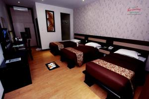 A bed or beds in a room at Kusuma Agrowisata Resort & Convention