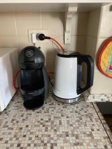 A kitchen or kitchenette at Appartamento luminoso