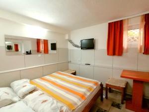 Posteľ alebo postele v izbe v ubytovaní Kosta House