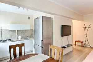 Кухня или мини-кухня в Leader NORD Apartments on Krasnaya Presnya