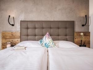 Ein Bett oder Betten in einem Zimmer der Unterkunft Mo's appartements