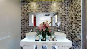 A bathroom at Residences at The Fives