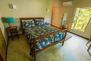 A bed or beds in a room at Ocacocar - Milagres