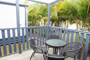 A balcony or terrace at Lazy Acres Caravan Park