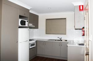 A kitchen or kitchenette at Lazy Acres Caravan Park