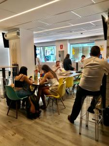 A restaurant or other place to eat at We Hostel Palma - Albergue Juvenil