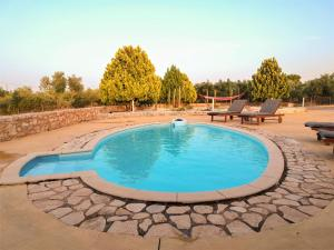 The swimming pool at or near Grey Haven Luxury Villa