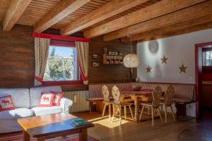 A seating area at Beautiful Chalet Carezza