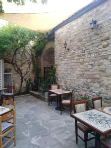 A restaurant or other place to eat at Lefkara Hotel
