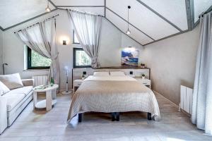 Кровать или кровати в номере Территория отдыха Hevaa