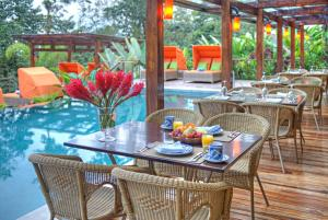 A restaurant or other place to eat at Nayara Springs - Adults Only