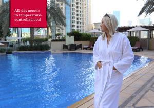 The swimming pool at or near Ramada Downtown Dubai