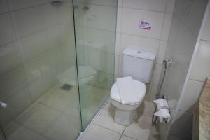 Um banheiro em Estância Avaré Hotel