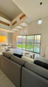 A seating area at 2 Private Luxury Villas side by side with a pool