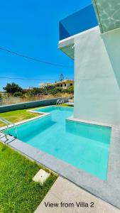 The swimming pool at or near 2 Private Luxury Villas side by side with a pool