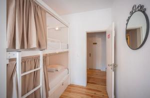 A bunk bed or bunk beds in a room at We Love F Tourists