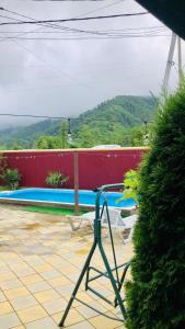The swimming pool at or near Guest House Eugenia