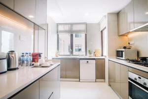 A kitchen or kitchenette at Great World Serviced Apartments (SG Clean)