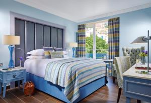 Ein Bett oder Betten in einem Zimmer der Unterkunft The Eliott Hotel