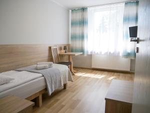 A bed or beds in a room at CKS Kraków (Centrum Konferencyjno-Szkoleniowe CS Natura Tour)