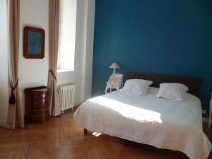 Un ou plusieurs lits dans un hébergement de l'établissement Château du Mesnil Soleil , gites et chambres d'hôtes