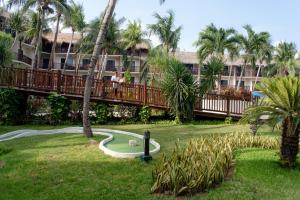 Een tuin van The Reef Coco Beach & Spa- Optional All Inclusive
